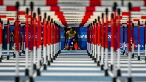 TOPSHOT - Barbados' Shane Brathwaite competes in the men's 110 m hurdles competition during the 2018 Central American and Caribbean Games (CAC) in Barranquilla, Colombia, on July 30, 2018. (Photo by Luis ACOSTA / AFP) (Photo credit should read LUIS ACOSTA/AFP/Getty Images)