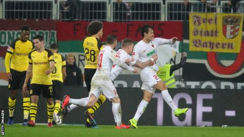 Augsburg players celebrate Ji Dong-won's goal