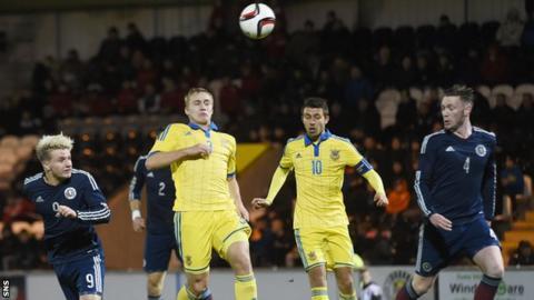 Jason Cummings heads a goal for Scotland Under-21s against Ukraine