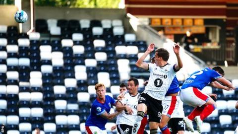 Anders Konradsen heads in the opener for Rosenborg against Linfield