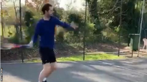Andy Murray hitting a ball