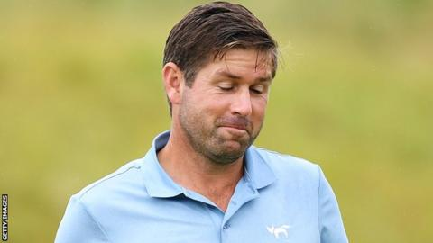Robert Rock looks almost bemused after knocking in a birdie putt at the 16th at Lahinch