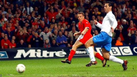 Craig Bellamy scores the winner against Italy on an unforgettable night at the Millennium Stadium in a Euro 2004 qualifier.