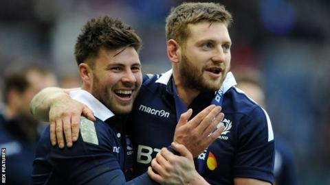 Scotland's Ali Price and Finn Russell celebrate against Wales