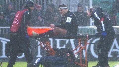 George Turner is taken off on a stretcher