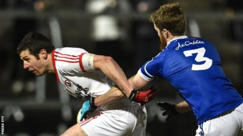 Sean Cavanagh is challenged by Cavan's Rory Dunne in last year's Dr McKenna Cup final