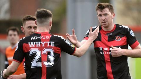 Gavin Whyte congratulates Crusaders goalscorer Billy Joe Burns