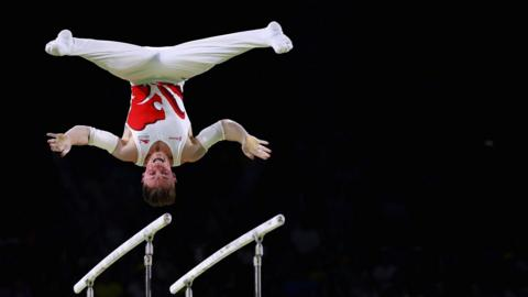 Nile Wilson of England competes in the men's parallel bars final on day five of the Gold Coast 2018 Commonwealth Games