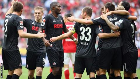 FC Koln players celebrate after the draw