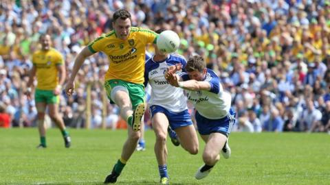 Martin McElhinney and Darren Hughes in action during a keenly contested Ulster decider at St Tiernach's Park