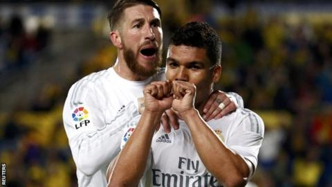 Casemiro celebrates his winner with fellow scorer Sergio Ramos
