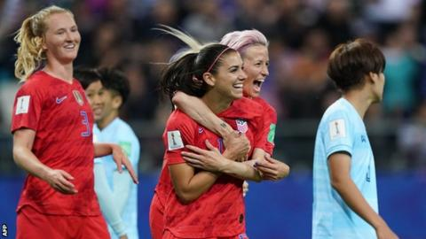 USA's Alex Morgan celebrates scoring against Thailand