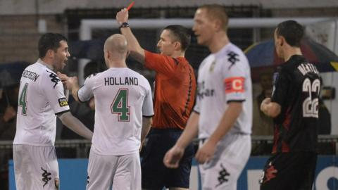 Niall Henderson becomes the second Glentoran player to be sent-off against leaders Crusaders at Seaview