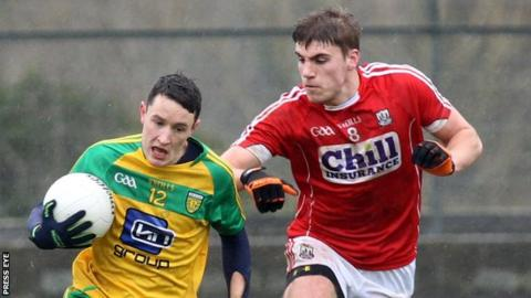 Cork's Ian Maguire tries to keep pace with Donegal's Eoin McHugh