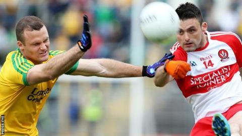 Neil McGee of Donegal in action against Derry forward Eoin Bradley