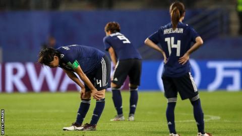 Japan players react