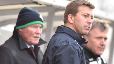 Ronnie McFall and Pat McGibbon in the Portadown dugout earlier this season