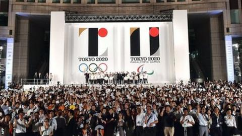 The logo for Tokyo 2020 is unveiled outside Tokyo City Hall