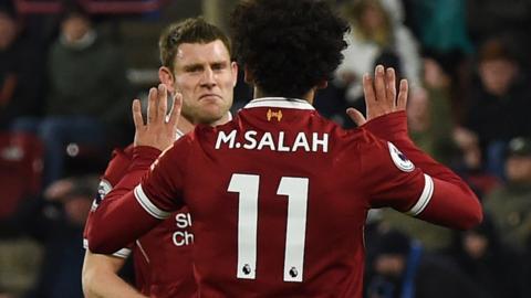 James Milner celebrates with Mohamed Salah
