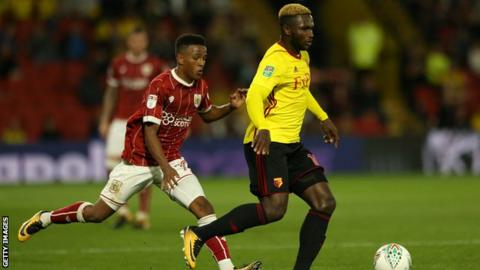Isaac Success of Watford holds off Niclas Eliasson of Bristol City