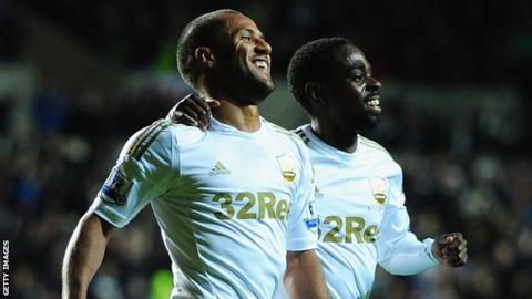 Wayne Routledge and Nathan Dyer celebrate a Swansea goal
