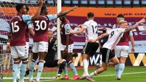 environment Aston Villa keeper Orjan Nyland tries to prevent a goal