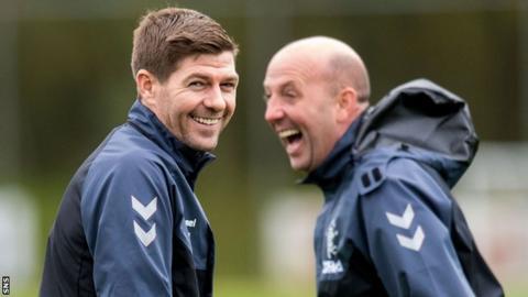Rangers manager Steven Gerrard shares a joke with assistant Gary McAllister during training