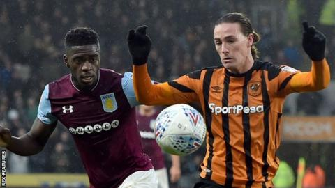 Axel Tuenzebe and Jackson Irvine battle for the ball