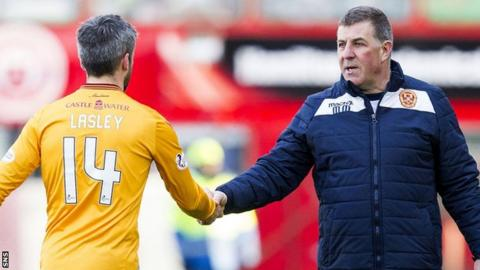 Motherwell captain Keith Lasley and manager Mark McGhee