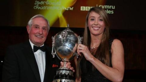 Taekwondo athlete Jade Jones receives her award from rugby great Gareth Edwards