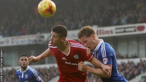 Cardiff striker Alex Revell wins a header in the Ipswich box