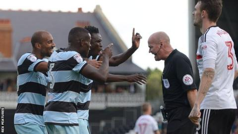 Karl Henry, Nedum Onuoha and Idrissa Sylla remonstrate with referee Lee Mason during QPR's 2-1 win over Fulham