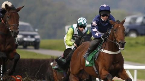 Paul Maloney riding Roadie Joe (right) on their way to winning The totepool Persian War Novices' Hurdle Race at Chepstow