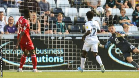 Swansea keeper Freddie Woodman is unable to reach Alfa Semedo's late strike