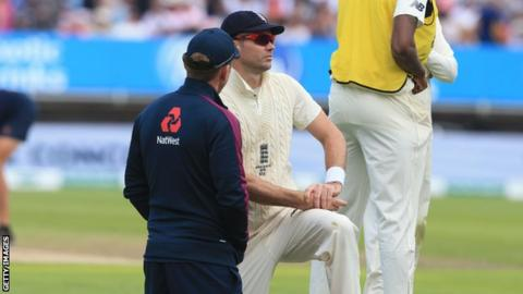 England bowler James Anderson receives treatment from a physio on day one of the first Test against Australia