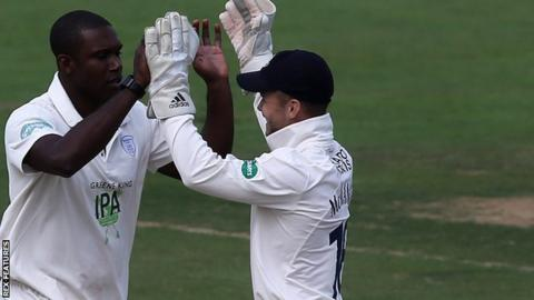 Keith Barker celebrates a wicket with his team-mates