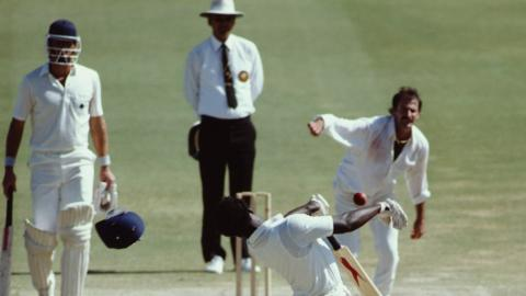 Norman Cowans loses his helmet to a Dennis Lillee bouncer