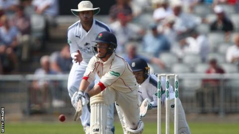Alex Davies sweeps against Hampshire at Old Trafford, on the way to his third County Championship century this season