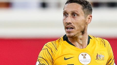 Mark Milligan in action for Australia