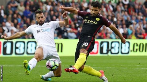 Jordi Amat (left) challenges Manchester City forward Sergio Aguero
