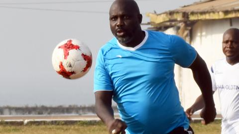 President George Weah playing football in Monrovia, Liberia
