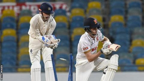 Essex batsman Callum Taylor is bowled by Dom Bess