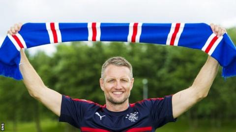 Clint Hill with a Rangers scarf