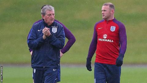 Roy Hodgson and Wayne Rooney