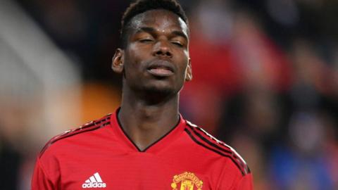 Manchester United midfielder Paul Pogba closes his eyes in frustration