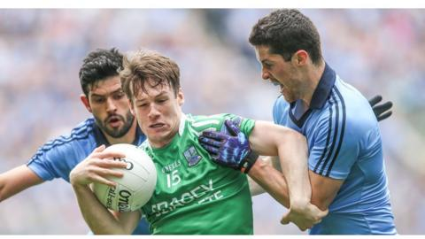 Dublin duo Cian O'Sullivan and Rory O'Carroll close in on Tomas Corrigan in the second of the All-Ireland quarter-finals