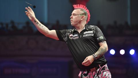 24th July 2019, Empress Ballroom Winter Gardens Blackpool; 2019 Betfred World Matchplay Darts; Day Five; Peter Wright throws his dart (photo by Simon Whitehead/Action Plus via Getty Images)
