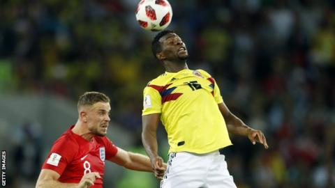 Jefferson Lerma wins a header during Colombia's defeat by England at the World Cup