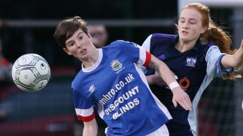 The battle for the NI Women's Football League went down to the final match at Rathmore on Wednesday. Here, Kirsty McGuinness of leaders Linfield Ladies competes with Newry's Blaithin Mackin