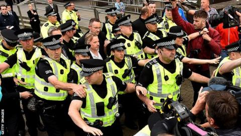 Craig Whyte is given a police escort leaving the High Court in Glasgow in September 2015